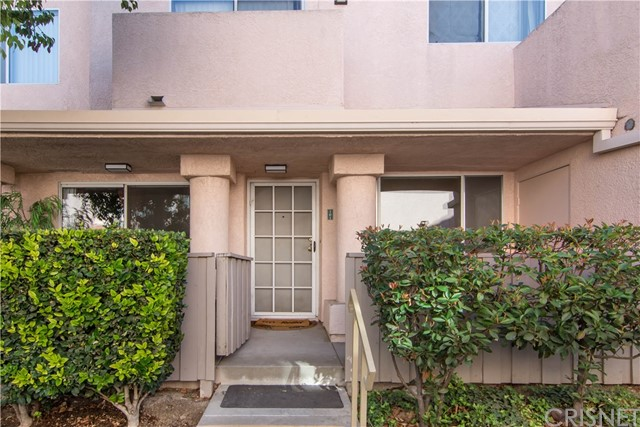 Located on the First floor, 1 bedroom condo with single car attached garage plus 1 outdoor assigned parking spot! Great Price and great location in the complex, just steps away from guest parking.Just painted.  Own private porch/patio.  Minutes away from local showing,  restaurants and freeway access!