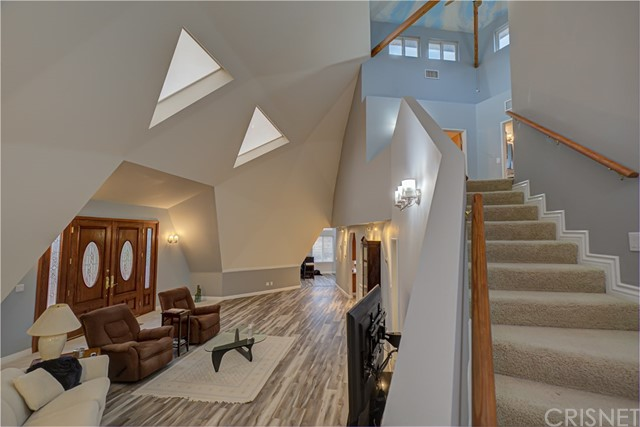 View of the front room and stairway to upstairs.