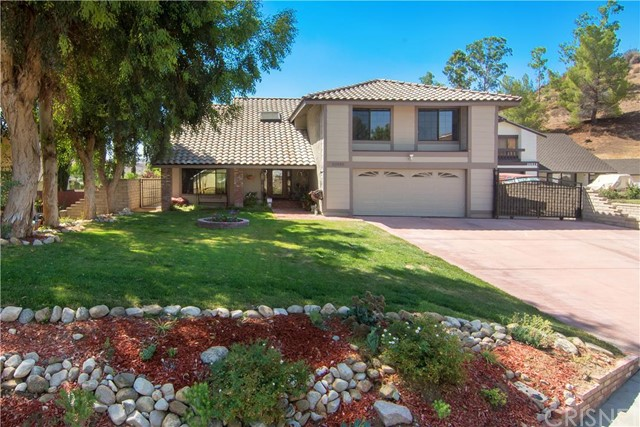 LARGE RV HOME ON A CUL-DE-SAC in Saugus!  RARE FIND! 4-Bedrooms and 2 1/2 Bathrooms with over 2,300 Square Feet.  4th bedroom currently being used as retreat to the master bedroom.  Large front driveway with extra large RV access. HUGE pool size back yard and plenty of room for extras! Home sits on a larger lot of over 11,440 Square Feet.  Private yard! Mountain Views, Red-Brick Ribbon hardscape , newer covered Patio, above-ground Jacuzzi, Fire Pit.  Updated Kitchen and Bathrooms, Laundry area inside, unique wood paneled vaulted ceilings, and larger Master Bedroom with separate Sitting Area.Balcony off the master bedroom.  NO HOA and NO MELLO ROOS!