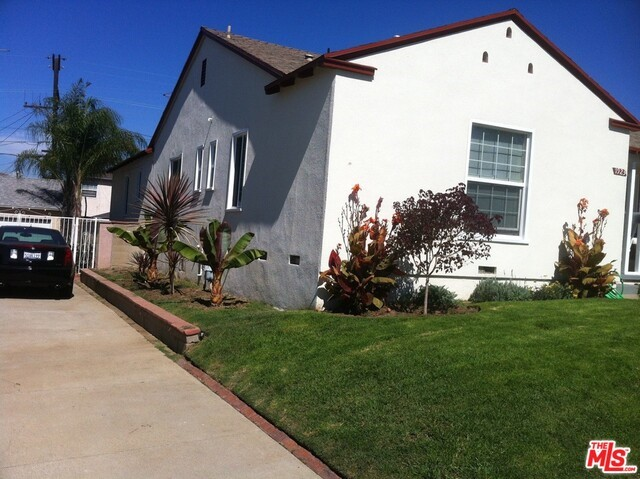 Photo of home for sale at 1923 115TH Street W, Los Angeles CA