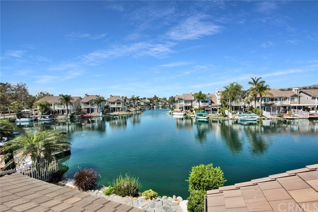 Rare detached sought after lakefront home on Yorba Linda's beautiful community of Eastlake Shores. Enjoy resort style living year round in this beautiful move-in ready three bedroom, three bathroom home. Your own private boat included with private boat dock. Ideally located on the lake offering breathtaking views from all rooms and professionally landscaped wrap around patio complete with relaxing jacuzzi and fire pit. Updated kitchen with stainless steel appliances, travertine flooring, breakfast nook with French doors, and many windows with gorgeous lake views. Spacious living room includes fireplace, room enlarging mirrored wall, and French door to patio. Formal dining room locate off of living room and includes French doors to access rear patio. Large master bedroom offers retreat area with fireplace, walk-in closet, vaulted ceilings, and private balcony with lake and hills view. Sizable master bathroom includes dual sink vanities, large oval bathtub and separate shower. Two spacious guest bedrooms with guest bathroom upstairs. Downstairs guest bathroom with shower and convenient laundry closet. Enjoy the relaxing and peaceful 15 acre lake, community pool, spa, gym, and clubhouse.