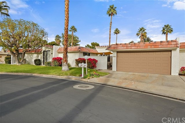 This home is a gem in the desert! Only steps away from the pool and spa which is shared with only a few neighbors. Located in the desirable Cathedral Canyon Country Club with its own golf course, tennis club, and JAX restaurant on site. It is conveniently located close to shopping, dining, entertainment, and the airport. Enjoy the beautiful views with your preferred drink from your personal covered courtyard. This lovely turn-key 2-bedroom, 2 bathroom (3/4 and 3/4) 1,550 sq ft condominium welcomes you into a bright spacious living room with dining area and sliding doors to the patios. Elegant plantation shutters throughout the house. The bright master suite has a make-up counter and extra sink. The spacious second bedroom with easy access to bathroom. Large den currently used as an office, could easily be transformed into a third bedroom. 2-car garage, laundry in the garage, but laundry hookup available for a stackable washer/dryer inside. The most recent upgrades include new flooring in both bedrooms and fresh pain throughout. Its a must see, so book your appointment. This opportunity wont last.