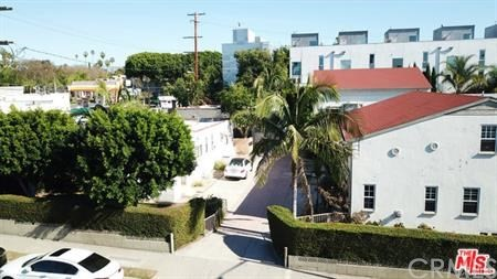 8 units situated on a huge double lot totaling 13,101 square feet with a 100 ft front lot width, which allows for a 12 unit luxury development with significant architectural creativity and maximized parking spaces. Located on the corner of Santa Monica Blvd and Crescent Heights Blvd, one of the best rental locations at the center of prime West Hollywood and close to Beverly Hills. Property is also suited for buy and hold investors, given rental income with tremendous long term upside. Site consists of 4 separate buildings. There are five - two story 1 bed+1 bath units, two - single story 1+1's, and one - single story 2+1. Three separate garden/patio areas, two - 2 car garages and 8 other parking spaces.