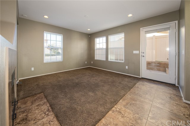 Living room and access door to back yard