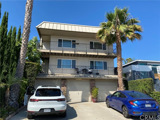 Beautiful upstairs unit of a duplex in the charming Capistrano Palisades neighborhood. Ocean Views Galore out the living /dining area and front outdoor balcony. Remodeled 3 bedroom, 2 bathroom unit. Parking includes a 1 car enclosed garage and additional parking space on driveway. Go upstairs to your single level unit which has an updated interior. Entire unit has been freshly painted with neutral colors. Open a window and door for wonderful cross breezes. Great air flow! Interior has tile and wood flooring (no carpet), lots of built-in storage, stone counter tops, newer glass shower enclosures and quality doors and windows. Kitchen has nice appliances and is equipped with a built in microwave and refrigerator. Newer Mitsubishi zoned AC/heaters are in 3 rooms. In addition there are ceiling fans in two bedrooms. The unit has a backyard that is tropically landscaped, fully fenced with a gazebo and mature fruit trees. This is a BEAUTIFUL backyard!! Backyard is shared by unit A and maintained by gardener. This unit is located near world class beaches, shopping, schools and easy freeway access. Great residential neighborhood.