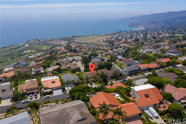 First time on the market in over 45 years! Here's a fantastic opportunity to own a great home with SPECTACULAR unobstructed ocean views in this desirable Mira Catalina neighborhood.  Located on a quiet cul de sac street, this 4 bedroom, 3 bath home has been lovingly cared for and well-maintained.  An ideal floorplan offering one bedroom, living room, family room, breakfast dining, kitchen, and separate formal dining room on the main level.  Second level features a large master suite (on the view side!) with a private bath, 2 additional bedrooms, and a jack and jill bath bathroom.  Master includes an enclosed patio/sunroom that gives a great feel and added dimension to this space.  Beautiful outdoor patio area with newly refinished tile surfaces, wooden gazebo, lovely flower garden, and substantial grassy lawn.  Precious, unobstructed views of our coastline, Catalina Island, Point Vicente & Abalone Cove marine conservation areas, and the luxurious Terranea Resort.  Attached three-car garage with direct access and a separate laundry room. Blink and you'll miss this great find!