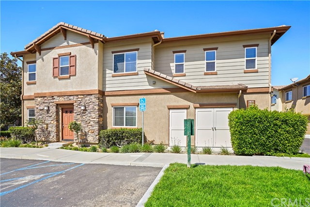 This spacious and beautiful 4 Bedroom, 3 Bath townhome is located in the highly desired and centrally located Sycamore Shades community which features numerous amenities such as a pool, spa, gated entrance and easy access to freeway and shopping. As you enter the home you are greeted with an open and spacious living room with recessed lighting and a cozy fireplace. The living room transitions flawlessly into the kitchen which features hardwood cabinets and a sizable center island with built in sink and granite counter tops. Also downstairs is a bedroom and bathroom with standup shower, perfect for guest use. Upstairs you will find a large master bedroom and well appointed master bathroom which boasts dual sinks, a soaking tub, a separate standup shower and large walk in closet. Also upstairs are 2 spacious bedrooms with ample closet space, laundry room with built-in linen storage and a loft perfect for use as an upstairs office, kid's play area or upstairs living room. This home also features an attached two car garage with direct access to the home for added convenience and a private outdoor patio just off the living room. Don't let this amazing opportunity pass you by!