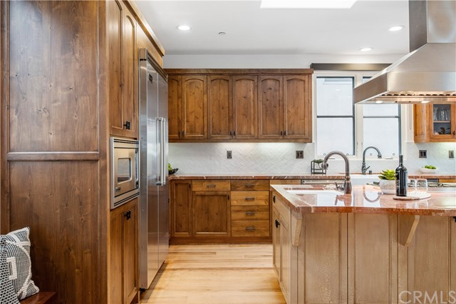 Kitchen features refinished hickory, wide plank hardwood floors, tons of cabinets and expansive counter space.