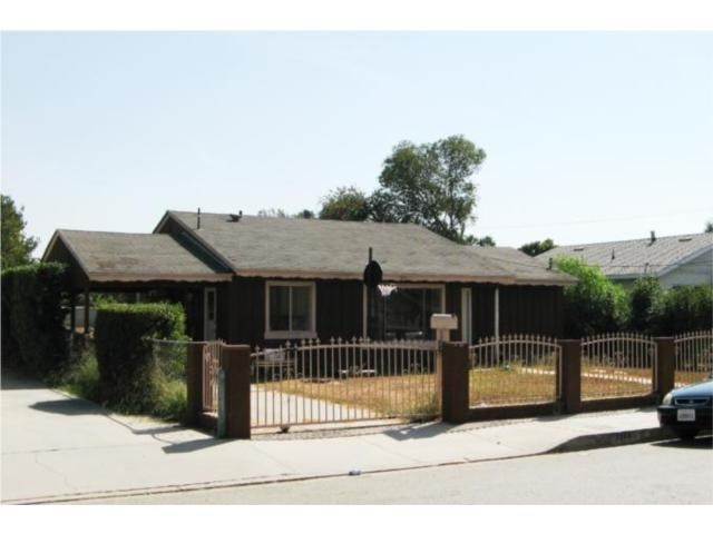 (According to the City of Pomona, 2 more houses can be built or tear down the existing house to build 3 new houses, See supplemental) The current house offers 3 large bedrooms and 1 bathroom with approximately 1,200 sq. ft. of living space. The property is gated for privacy on a huge flat lot approximately 13,000 sq.ft. for all your cars and RV parking or playing football in the back yard. Features include a spacious living room with an open floor plan, newly remodeled with a newer kitchen, bath, paint, tile, and wood flooring throughout the house. Close to Cal Poly Pomona, the 71, 57, & 60 FWYs, also within walking distance to the Palm Lake Golf Course and Ralph Welch Park. Extremely rare to find a property with this size of lot can build 3 houses in a great neighborhood located 1/2 mile from Phillip Ranch and Diamond Bar with 3 new homes under construction across the street with same size lot. There is new large shopping center within a miles away from subject property off the 71 FWY. Priced below market for a quick sell; Seller will be doing a 1031 exchange.