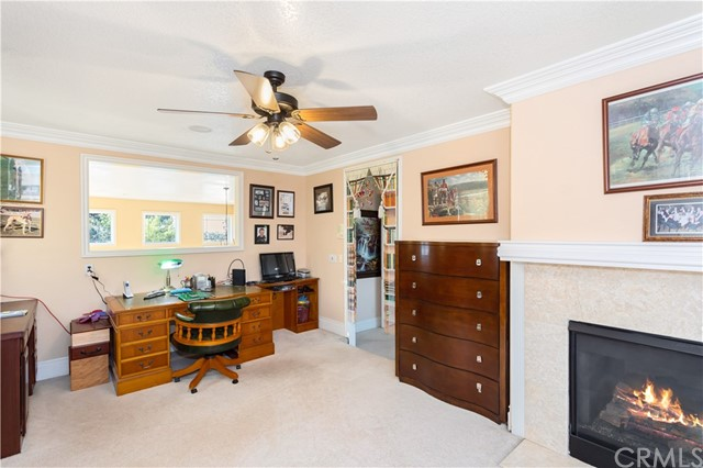 Library/Office area off Master Bedroom with window overlooking Formal Living Room