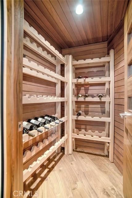 Wine room is located adjacent to media room