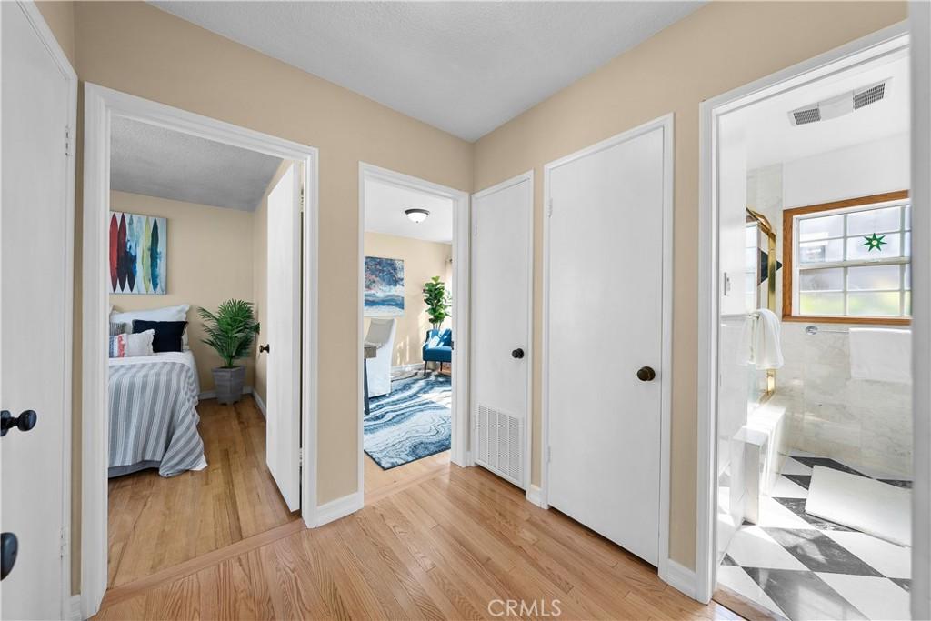 Hallway leading into bathroom and bedrooms