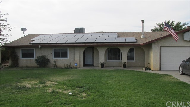 This beautiful well maintained Pool home in Victorville won't last. Large lot with RV access. New tile and carpet in most of the home. Nice bonus room with additional fireplace off kitchen. Wood burning stove in Living room for those cool cozy days. In ground pool and patio for the warm summer days. Come see!!!