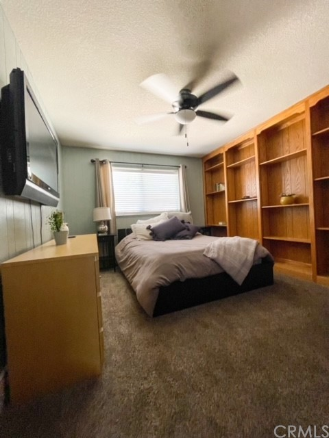 Main level guest bedroom or office with solid oak shelving.