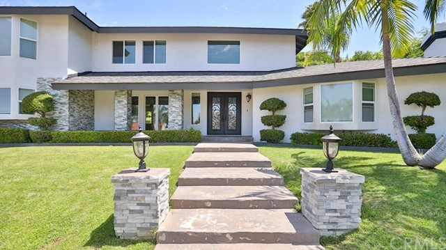 Privately street . Privately gated One Of A Kind Custom Home sitting on a 22,100sqft Lot At The End Of A Cul-de-sac. Beautiful Circular Driveway with gorgeous fountain view. Beautiful private entertainers backyard with sparkling pool, spa, Fabulous Rock Waterfall, Fire Pit, and patio covered built in bbq. Stunning entry with double doors that show an open floor plan and wrap around staircase. Remodeled Kitchen with island and stainless steel appliances. 2 Cozy Family Rooms with Fireplace. Master Suite with City Light View balcony along with private bathroom with jacuzzi tub and his and her showers. Oversized 3 Car Garage. This is a completely upgraded home ready for a family. Brand new paint, bar, roof etc.