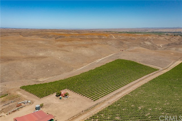 Located in the desirable Highlands District of Paso Robles AVA, this remarkable 640 acre property includes 47+ acres of planted vineyards and 4.25 acres of pomegranates. Known for award-winning wines, Judd Vineyard is currently leased through 2022. Celebrated varieties include: Cabernet Sauvignon (14.79 acres), Malbec (7.18 acres), Petit Verdot (5.58 acres), Barbera (6.93), Tempranillo (9.18), and Muscat Canelli (4.1 acres). Covered by The Williamson Act, expect a rare property tax reduction as well. Beyond dual wells (one on property and one on a deeded easement of the neighboring property) you'll also find an underground water distribution system, 1.5-surface-acre lined reservoir, two water storage tanks, and a vineyard irrigation system. All water runs through a filtration system. Ideal for farming, the soil is predominantly Arbuckle-Positas complex and Balcom-Calleguas complex with Balcom-Nacimiento and Chanac Loam. Recent improvements include two storage buildings and hay pole barns. Gated and fenced for cattle. Perfect for the savvy agricultural investor, this Paso Robles property is ripe for long-term success.Located in the desirable Highlands District of Paso Robles AVA, this remarkable 640 acre property includes 47+ acres of planted vineyards and 4.25 acres of pomegranates. Known for award-winning wines, Judd Vineyard is currently leased through 2022. Celebrated varieties include: Cabernet Sauvignon (14.79 acres), Malbec (7.18 acres), Petit Verdot (5.58 acres), Barbera (6.93), Tempranillo (9.18), and Muscat Canelli (4.1 acres). Covered by The Williamson Act, expect a rare property tax reduction as well. Beyond dual wells (one on property and one on a deeded easement of the neighboring property) you'll also find an underground water distribution system, 1.5-surface-acre lined reservoir, two water storage tanks, and a vineyard irrigation system. All water runs through a filtration system. Ideal for farming, the soil is predominantly Arbuckle-Positas complex a