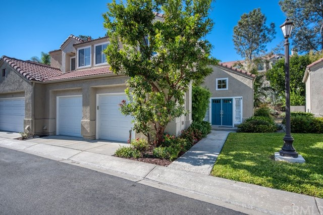 It doesn't get any more private than this condo in Aliso Viejo! End unit, on a greenbelt, recently updated...What more do you want? As you enter the double doors, you will immediately notice how bright and open this floor plan is due to the vaulted ceilings and updated light flooring. Making your way past your fireplace and large entertaining area, you will immediately be taken back by the large kitchen containing a farmhouse sink, stainless steel appliances and plenty of counter space. Adjacent from your oversized kitchen are two sliding doors opening up to your own private backyard. You will immediately notice the lack of neighbors and mature landscape . Enjoy weekend barbeques and entertaining in complete privacy! Rounding off the downstairs is a recently updated garage with refinished floors and paint. Perfect for storing your two cars and plenty of toys! As you walk up the stairs you will be greeted by large skylights while heading into the master retreat. The large master bedroom and bath have a private patio and vaulted ceilings giving your entire master retreat a very grand feel! Two additional bedrooms and a bathroom complete the upstairs. While the home has a very open and bright feel, the current owners spared no expense adding brand new recessed lighting. Additional upgrades include a 1 year old AC unit and tankless water heater! Located in the highly sought after community of California Renaissance, this community has a large resort style pool and spa!