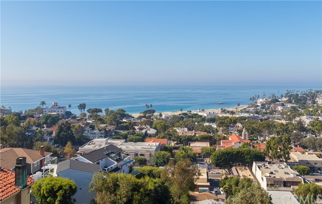 Enjoy breathtaking views from the entire back of this home and take in the most beautiful California coast.  See the waves lap up on the shore!
