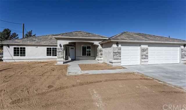 GORGEOUS New Construction with a new open floorplan! Situated on the MESA with lovely views of the desert. Four Bedrooms & 2.5 Baths. Large Kitchen with with water fall countertop island, tile flooring, lots of cabinets & large pantry. Master with Large Closets & Separate Modern Tub & Shower. Separate Family Room w/ F.P & tile flooring. Large Kitchen with with water fall countertop island, Formal Dining Area, Breakfast Nook, Indoor Laundry & 3 car garage. Property is still under construction. Photos of similar property. ETA is in February.