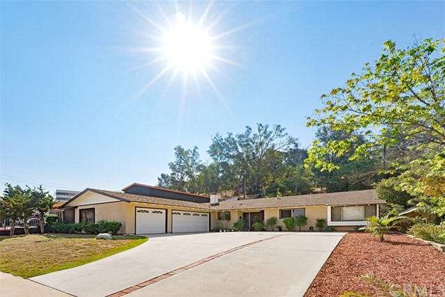 Welcome to a charming and spacious home located in Orange with a .29 acres (or >12,600 sft) lot size.  A very rare area of homes for sale.  This spacious and inviting home offers a big and wide driveway, 3 car garage with a wall of storage closets, 4 bedrooms, 2 bathrooms, 1,860 living sqft, huge living room and dining room for big families or have a lot of families and friends gathering.  Bright and Shine home.  Great opportunity for a family with kids or investment property to rent.  Close to Schools, mall of Orange, shopping, restaurants, parks, river trails, and freeways.  Will sell fast!  Come and see!