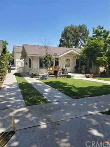 Rare 3 Unit Fullerton vintage home with a unique blend of original charm and designer upgrades. This home is near the heart of downtown Fullerton, just a 2 min walk away from shopping, great dining, entertainment, and the Fullerton Transportation Center. The curb appeal of this home is picture perfect: located on an old-growth, tree-lined street with sought-after craftsman architecture, and a large front porch.  This rare find boast the highest pro-forma return of any recent 3 unit in Fullerton.  Appealing to Investors or owner occupied owners that want to off-set their monthly expenses with rental income.
