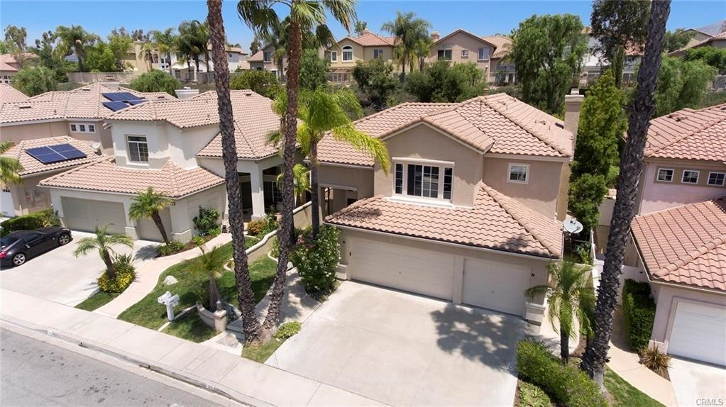 Beautifully updated 5 bedroom/3 bath home in the Melinda heights area of Rancho Santa Margarita. 3 car garage. New carpet, new paint, newer granite kitchen and center island counter tops. 2 story high volume entry ceilings. Separate formal dining room. Eat-in kitchen with Whirlpool and Maytag stainless steel appliances. Cozy fireplace and built-in entertainment unit in large family room. Main floor bedroom and bathroom with shower stall. Inside laundry room with side yard access. Sweeping staircase leads to the upper level. 3 spacious bedrooms and bonus room, all with ceiling fans. Large Master suite with romantic fireplace. Master bathroom has new flooring, walk-in closet, separate tub and shower. Dual vanities. Private Entertainers backyard with built-in BBQ w eat at bar and new grassy area. Close proximity to elementary school, parks and church. Enjoy the association pools, beach club and many parks! Easy access to toll road and shopping center.