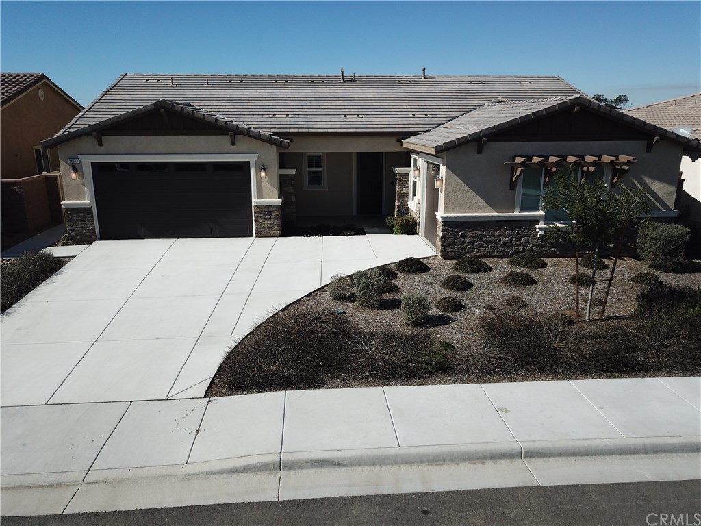The TRUE TURNKEY home you've been waiting for! This immaculate 2016 KB Premium View Lot, single story home in Murrieta will knock your socks off. Inside you'll discover 2,343 square feet with shutters and gorgeous laminate wood flooring throughout: NO CARPET!  Offering 3 bedrooms, including a large master bedroom with a walk-in closet, plus an office. Spacious, open concept kitchen with center island, upgraded counter tops, abundant storage & walk-in pantry.  2 car garage with a separate single garage. Super LOW maintenance, water wise landscaping welcomes you in the front and back areas with an artificial lawn & drainage in your backyard. An extensive Alumawood patio cover runs almost the entire length of the home with 2 ceiling fans and a huge concrete patio making entertaining and enjoying your outdoor space a delight.  There is no other house directly behind yours: it backs to a greenbelt and walking trails. Wrought iron & vinyl fencing surround the property. What are you waiting for?  Close to multiple public parks, this home also has incredibly low HOA dues ($35 per month and include common area maintenance) AND the home still has some KB Home warranties that transfer to the new owners! Hurry! This one won't last!
