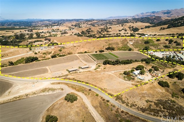 Rare 55 acre parcel only 9 minutes from the Village of Arroyo Grande! Improvements include a 4-bedroom, 3-bath manufactured home built in 2007 and a second 3-bedroom, 2-bath manufactured home built in 1985. Other improvements include an older barn, a pipe equestrian arena and a 20-stall horse barn. Other amenities include approximately 8 to 10 acres of irrigable farm land. Many possible uses including a private ranch, horse boarding and training facility, farm to table agricultural operation, cattle or sheep grazing, or collect rental income from the many possible income sources while you plan your future dream property. Subject property benefits from the area micro climate while enjoying the coastal influence. Water is provided by 3 wells on the property. Nearby farming operations include citrus, mushrooms, vegetable crops and flowers. The central location provides easy access to the beach, Edna Valley, Village of Arroyo Grande, all while being only 20 minutes from the San Luis Obispo Regional Airport.