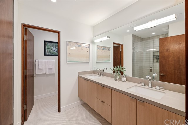Decadent bath with dual sinks, designer tile selections and custom cabinetry