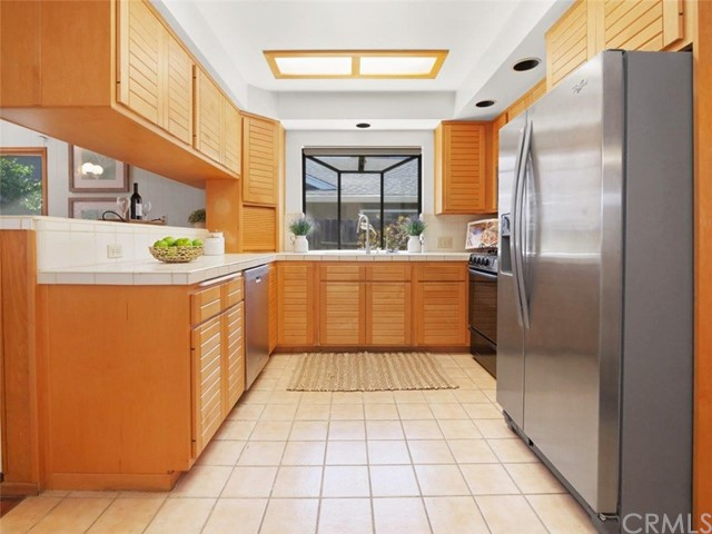 Another view of the kitchen with updated cabinetry and stainless steel appliances