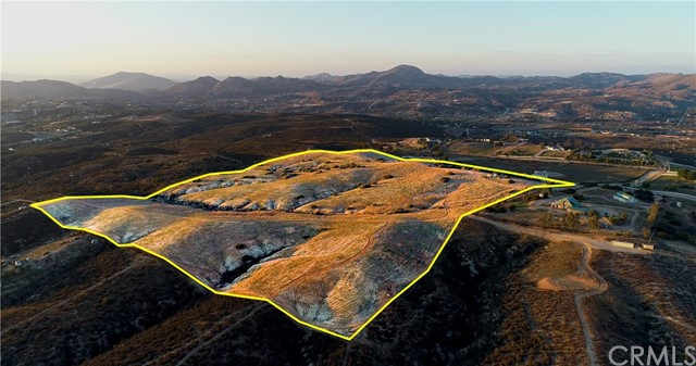 39.12 acres with 365 degree expansive views of Temecula Wine Country and Santa Rosa Plateau to the West; Mount Palomar to the South East; San Jacinto Mountains to the North; rolling hills and country estates surround this property. This parcel is situated on a plateau with mountain views surrounding and has tremendous development potential. Possible to subdivide into 6-8 home sites all with views. Ample land and terrain for vineyard, orchard, horses, cows, goats.....Potential uses are for a large home site/ranch; rural sub-development of 5+ acre homesites/ ranches. Boundary lines are fenced with at least one locked gate on all four sides; 600' well with new 1.5 h/p pump; electric will be brought onto the property. Seller in the process of installing a water holding tank and permit to add electricity to the property has been granted (as of Feb 20, 2020). This site is well positioned to capture the afternoon breezes that Temecula is known for. The pictures are nice, but you will have to visit this property to get the full appreciation for the natural beauty it provides.