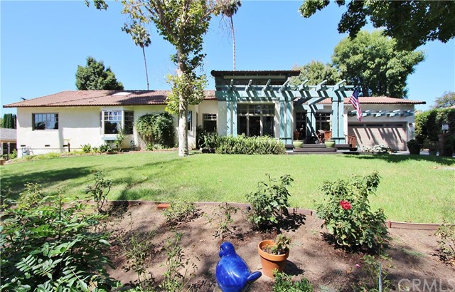 This is a beautiful home,in a great setting,close to Hermosa school,and sits on a 32,640 square foot lot.There are 2 parts to this lot separated by a private road that is owned by the seller.The bottom portion of the lot currently has a parking pad(which can be used for an R/V, Trailer, a boat, toys, or just additional parking) and a large storage structure.Check w/city for building options,or a potential sports court,tennis court,additional garage, ADU, workshop..etc.The home features:a raised front porch,formal entry surrounded by custom windows,an open Living room w/tons of natural light,vaulted ceilings,canned lighting and Brazilian cherry wood flooring.Open family room(w/ fireplace),open Kitchen w/island,a down draft 6 burner cook top,a double oven,and lots of counter space(upgraded).There are two wings of the home,one of which has 2 bedrooms and 1 bath (w/walk in shower),direct access to the finished garage w/pull down access to attic storage,and inside laundry.The North wing has 2 beds,an office,3 baths,and a bonus room (that is currently being used as an art studio, and overlooks the pool).The master bedroom has a custom bay window,wall to wall closet,master bath w/separate shower,Jacuzzi tub,and double sinks.The 2nd bedroom has attached bathroom,and the 3rd bathroom is situated next to the Art studio/bonus room.The backyard features a covered open beamed patio, a beautiful pool and spa with slate decking. The yard is large with a swing set and zip line for the kids.