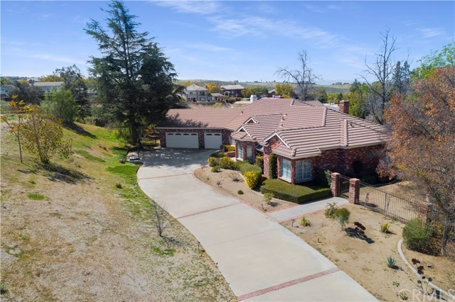 Alessandro Heights-Crystal Ridge Estates Elegant single level residence custom built by Don Dimanno.  Attractive used brick exterior yields to a warm and inviting interior of spacious living spaces including the formal living and separate formal dining rooms; large island kitchen with breakfast nook; adjoining massive family room with open beamed vaulted ceiling and used brick fireplace;  Luxurious master suite with retreat; over-sized bath with jetted tub and sauna and walk-in-closet;  Huge secondary bedrooms each with an adjoining bath.  Elevated 2+ acre view lot with long private driveway expansive fenced rear yard surrounded by natural open space.