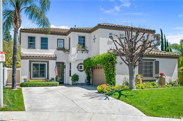 Welcome to this amazing highly upgraded La Montana home set on a large private cul-de-sac lot. There has been no expense spared! This hard to find home features a beautiful PRIVATE POOL & SPA w/LARGE WRAP AROUND YARD with GRASSY PLAY AREA for kids. There are five bedrooms + a den/wine room and 3 baths. One of the bedrooms is conveniently located on the FIRST FLOOR. Gorgeous wood plank engineered flooring, Berber carpeting & custom baseboards are found thru-out. Soaring ceilings, natural light & walls of glass allow for a seamless transition indoors to out. The formal dining room & living room feature volume ceilings & walls of windows. NEWER ANDERSON DOORS & WINDOWS, A FULLY PAID SOLAR SYSTEM, SOFT WATER SYSTEM, NEWER A/C UNIT, ELECTRIC CAR CHARGER, VIVINT SECURITY SYSTEM, RECENT EXTERIOR PAINT, CLOSET ORGANIZERS, CUSTOM WINDOW COVERINGS and RECENT PEX REPIPE COMPLETED. French doors open to the beautifully landscaped paver stone patio with wood covers, salt-water POOL & SPA, custom planters with lighting & large grassy side yard with views of the hills. In addtion to the 5 bedrooms there is a den w/built-in wine racks & cabinetry currently set up for wine tasting. The gourmet kitchen & dining area is a chef's delight with double doors overlooking the side yard, richly stained maple cabinetry, a center island, granite counters, a gas cooktop range and KitchenAid dishwasher.  The kitchen opens to the family room & features a fireplace & custom built in entertainment center. A lovely turned staircase leads to the second level w/4 bedrooms & a laundry room. The MASTER SUITE features a fireplace & balcony offering views of the distant mountains. The luxurious recently upgraded master bath features a CUSTOM walk-in shower w/rain shower & frameless glass, a soaking tub, dual vanity sinks w/granite counters & a walk-in closet w/organizers. Secondary bedrooms include built-in desks & the hall bath features a CUSTOM walk-in shower w/sliding door. BRIZIO, DELTA & GRAFF bath fi