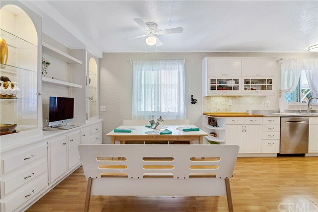 Large eat in area with beautiful custom built-in cabinetry, features inside lighting for displaying your special Items