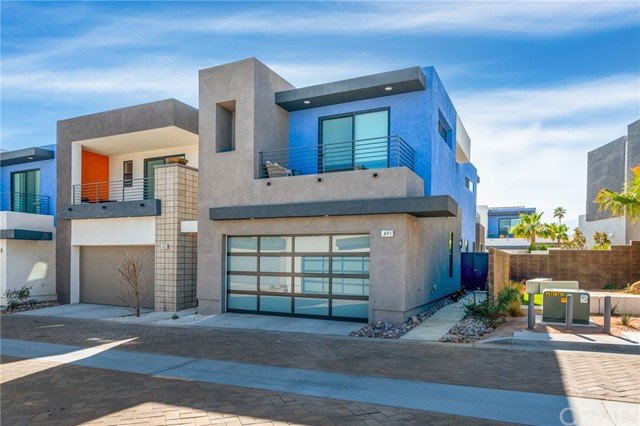Iconic living at its finest!! This 3 bedroom 3 bath is located in the brand new Icon community. It was built with green building techniques, paid solar and has an upgraded AC unit with separate upper and lower zones. Did I mention Views??? From several locations of this home, you will be able to enjoy the beautiful mountains that surround Palm Springs area. Whether you are standing on one of your 3 private patios or relaxing in your own private spa or heated pool the views are breathtaking! As soon as you walk into this home you'll feel the upbeat modern vibe. Featuring a wet bar, large living, kitchen, and dining area with two separate sliding doors to your outdoor haven. This home is one of the few large lots in this community. You'll have a large side yard with a built-in fire pit. The pool area has plenty of space for laying out or enjoying your favorite book and includes an outdoor shower. This home features 2 master suites upstairs each with a private balcony, large bathrooms, and walk-in closets. You will also find a large laundry room with plenty of cabinets and counter space. The third bedroom/office is located downstairs also with another full bath. There's an attached 2 car garage with beautiful glass doors with bronze trim. Wifi remote ready. This home is not only close to several popular places to visit in downtown Palm Springs but is also within minutes of the 10 freeway for your quick getaways.