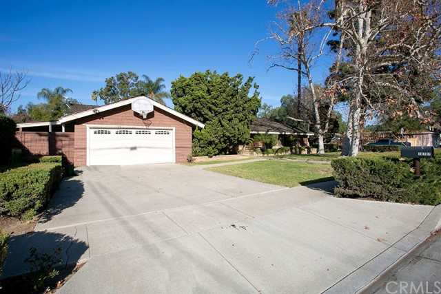 Great opportunity to own a single story rambler in sought after North Tustin! Offering 4 bedrooms, 2.5 baths in 2,492 square feet on a large, flat 15,354 square foot lot, this home is ready for a new owner. Large open living and family rooms open up to the generous backyard with pool. Large bedrooms are on one side of the house while the living areas are on the opposite side creating a wonderful floor plan. This home was loved and cared for by it's owner for many years. You can move right in or create your own masterpiece! Conveniently located in sought after North Tustin, known for larger lot sizes, great location and awesome schools. Hurry while it still is available.