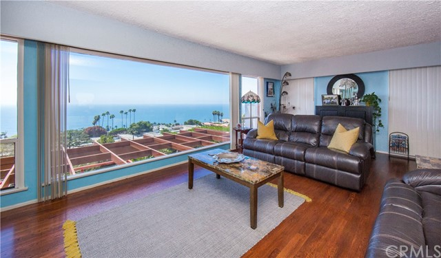 HUGE PRICE REDUCTION!  Great walk to the ocean! Great benefits and proven that people who live near the OCEAN LIVE LONGER!!!  you may live to be 100 years!!!  Wake up every morning to an unobstructed Ocean, white water, and Catalina Island view from almost every room.  Located in the very desirable Palisades area of San Pedro.  Mid-century home with 4 bedrooms and 2 bathrooms 2150 sq. ft. welcomes you. Step into a serene & peaceful courtyard surrounded by foliage and plants which adds privacy before you reach the front door.  Courtyard is great for meditating, having your favorite drink, or reading a book.  Two of the bedrooms add ample privacy for teenagers, parents, or if you need a private office, game room, music room, or exercise room.  Home has been lovingly appreciated and taken care of.  Joyfully cook your favorite meals while looking at the ocean!  Delight in the ocean facing back yard and huge deck which can handle fifty or more guests.  Memorable Family holidays have been celebrated on this oversized deck.  Walking distance to Point Fermin Lighthouse, park and The Korean Bell along with its numerous walking trails.  Walk to Yoga and Tai Chi classes which are held overlooking the SEA!!!  If you enjoy golfing, one of the best golf courses in Los Angeles is just minutes away with stunning ocean views as you tee off. Your own piece of California's beautiful coastline awaits you.  buyer to verify sq. ft.  SELLER VERY MOTIVATED AND WILL ENTERTAIN ANY REASONABLE OFFER!