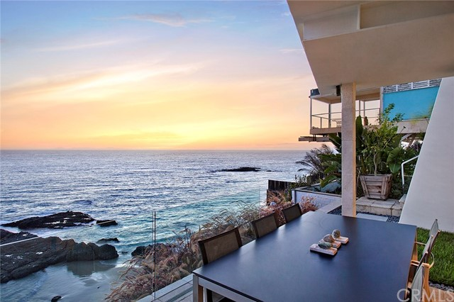 An extraordinary promontory location is the unique backdrop for this restyled contemporary oceanfront residence.  Floor-to-ceiling glass grants magnificent views of crashing surf, rock outcroppings, miles of coastline and stunning sunsets over Catalina Island.  Sleek contemporary finishes complete the luxurious ambience with imported stone flooring, glass and stainless steel railings, new gourmet kitchen, remodeled baths, three en suite bedrooms including full-floor master suite with private oceanfront terrace.  With incredible outdoor space and breathtaking views from all major rooms, this 2,500 square foot home is the perfect Laguna Beach retreat.