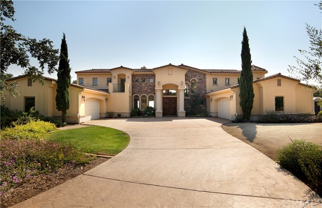 Enjoy this Tuscan style home with sweeping ocean views from almost every room.  Home sits high up on 5 usable acres in a gated community with views of the ocean, hills and valleys.  Over 5,000 sqft of luxury living with high ceilings throughout and an open floor plan flooded with natural light.  Master bath boasts of a huge walk-in shower and jacuzzi tub.  Never run out of hot water with 2 instant hot water  heaters with recirculating systems.  Cherry cabinets and granite counter tops throughout.  Solid Mahogany doors and oversized casement windows to maximize the views.  5 Bedrooms, 3.5 baths, 2 of the bedrooms and a full bath are downstairs, ideal for family and guests.  Grand entrance with Roman Columns, formal dining room, huge living room with double sided fireplace between the living room and family room.  Gourmet kitchen with extra deep counter tops, breakfast bar and nook.  4 Car oversized garages plus RV hookups. Outdoor living at its best.  Enjoy the beautiful sunset while cooking at your outdoor kitchen, wrought iron wood burning BBQ plus a natural gas grill and a fireplace to keep you warm, covered lounge area, granite counter tops, stainless steel cabinets and sink.   Beautiful large salt water pool with swim jets, LED lighting, oversized heating system, walk on pool cover, SPA and outdoor shower.  Zone controlled speaker system inside and out.  Ideally located just minutes from Arroyo Grande and SLO, near restaurants, award winning wineries, beaches and airport.