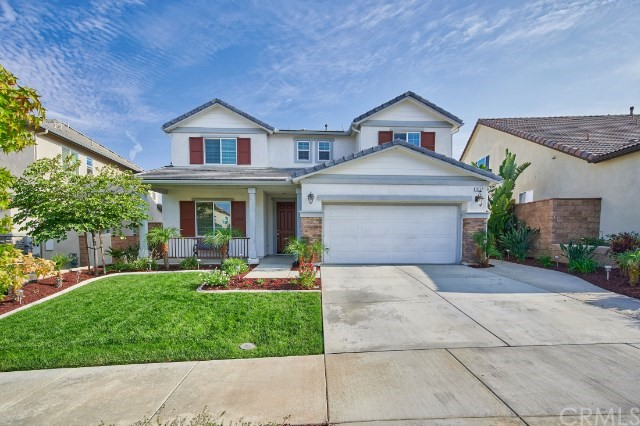 Welcome to the Aspen neighborhood in scenic Sycamore Creek!    This beautiful, four-bedroom, three-bath energy-efficient Corona home with upgraded downstairs flooring is a real gem!    Open concept kitchen with granite countertops and an oversize island with room for seating invites you in for a family meal.   The living room has a gas fireplace with nooks and an office/game room off to the side.   A spacious loft area greets you upstairs along with the laundry room that boasts storage cabinets and a sink. The luxurious master suite and its ensuite bathroom offers you a separate shower, soaking tub, and spacious walk-in closet.  Enjoy an immaculate backyard with patio cover, ceiling fan, extensive concrete work & beautiful landscaping!  Two car garage with an additional storage area and tankless water heater are just a few of the upgrades this home provides. The HOA offers community pools such as Jr. Olympic, Splash Pad and Waiter Pool, Clubhouse & multiple parks. Sycamore Creek HOA also offers complimentary tree trimming one time a year!     Nearby walking trails, grocery stores, and close access to the 15 FWY.    This home is amazing and won't last long!