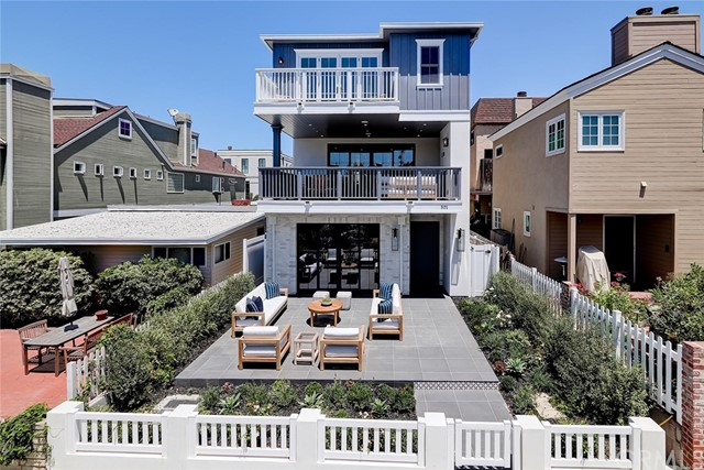 Located in the highly desirable 'Flat Walk Streets' in the South Manhattan Beach lies this beautiful new build from Pillar Homes. Designed by Waterleaf Interiors, the home boasts 5 beds, 4.5 bath, 4175 SF (BTV) including a 'beach room'. Entering on the ground level, walk into a an ample entryway with the 'beach room' to your left including a large bar with TV hooks ups and disappearing French door sliders out to a massive south-facing patio. Downstairs includes a 5th bedroom/bath and mud room. Upstairs includes large great room with three distinct areas defined by furniture not walls. This includes a large dining room area, open kitchen with 9' island, large wrap around peninsula, built-in breakfast nook, Thermador appliance package with custom stone and backsplash, including a private deck with BBQ, rear staircase, and a tucked away powder room. Towards the front is a massive great room with large fireplace, disappearing La Cantina French door sliders to an entertaining 'indoor/outdoor' deck with FP. Top floor includes master suite with large closet, French doors leading to a private deck with views of PV and the Hill Section, peak-a-boo ocean view, spacious bath with stand alone soaking tub, his/her vanities and large shower. Three more beds and private laundry room also encompass the level. Multi zone AC, Control 4 Smart home, 3 stop elevator, security cameras and the capability to run everything from your phone. A close walk to the beach, downtown and the park.