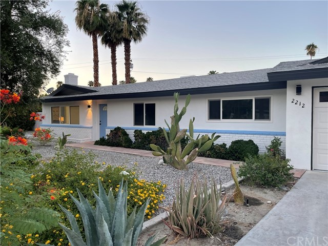 Welcome to this California modern Palm Springs pool home in the highly sought after area of Sunrise Park! Fully renovated, this entertainer's dream has been completely reimagined, inside and out. Upon walking in you will not only notice the fresh color scheme with an accented fireplace, but your eyes will immediately land on the waterfall quartz countertops directly below the focal point of an oversized natural finish wood beam. The open concept living space features three large bedrooms of which the master suite has a walk-in closet, as well as a separate sitting area with access to the backyard. Stylish finishes throughout the property make this home look and feel contemporary. Once you step outside into the massive sanctuary of a backyard, you will be ready to relax poolside in the afternoon sun and then soak in the hot tub in the evenings. Whilst in the compound, one cannot help but get the impression of full privacy with mature flora, separate sitting areas including a new pergola, and still a large enough area for a full sized volleyball court! If all of that was not enough, you are less than 1.5 miles from downtown! Do not hesitate as this one surely will not last.