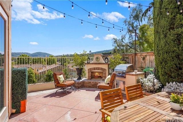This 4 bed, 2.5 bath home is all about the upgrades and canyon views! Tucked away in the private Tiburon community and sitting at the end of a quiet cul-de-sac, this beauty is perfect for your varied lifestyle!  The backyard is secluded and private, with outdoor fireplace, market lights, BBQ, and beautiful landscaping throughout! Kids will enjoy the outdoor play area marked by newly installed turf. The solar panels are owned and will save on your electric bill; the entire home has been re-piped with PEX!  Inside, you'll be charmed by an array of upgrades including Travertine floors, granite countertops, custom cabinets, recessed lighting w/dimmers, and Stainless Steel appliances.  Natural light illuminates at every turn!  The floorplan is open and airy - perfect for entertaining and living alike. You'll find the Master Suite spacious and relaxing, with amazing canyon views, a large tiled shower, and separate soaking tub.  With award-winning schools and plenty of outdoor hiking trails nearby, what's not to love about this beautiful community?  Schedule a visit today and don't miss your opportunity to make this special home yours!