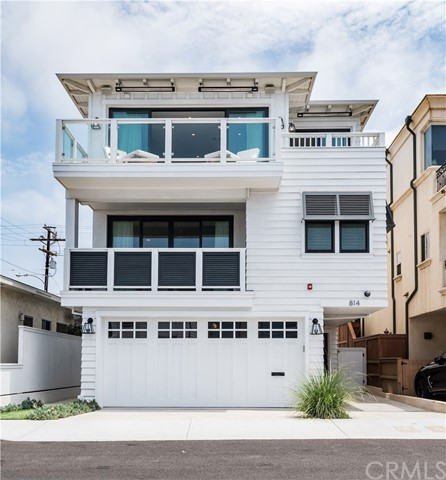 Beautiful Town Home in a perfect location close to the beach and all the fabulous restaurants and shopping that downtown Manhattan Beach has to offer. 4 bedrooms; 3.5 baths; 3 stop elevator; stylish,high end finishes and hardwood floors throughout. Amazing views from the patio located off the huge living area. Located in prestigious Robinson Elementary School district Beach living at its best!!