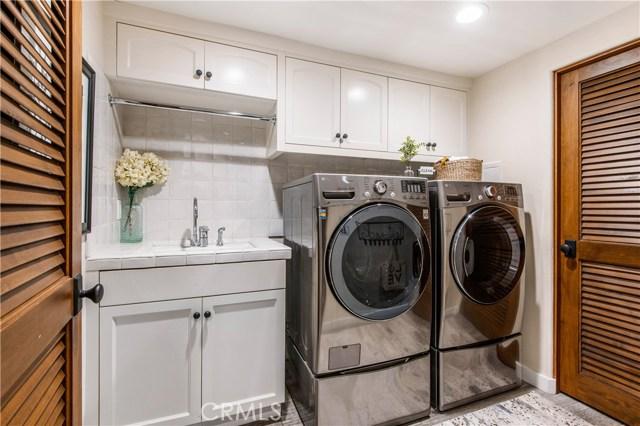 Laundry room and bonus storage room located on lower level.