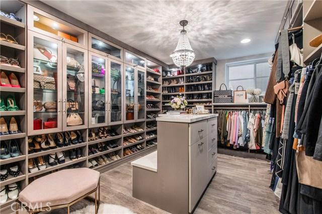 Custom designed closet easily holds 150+ pair of shoes!