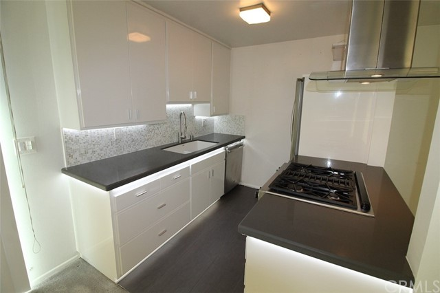 Open kitchen with range and dishwasher