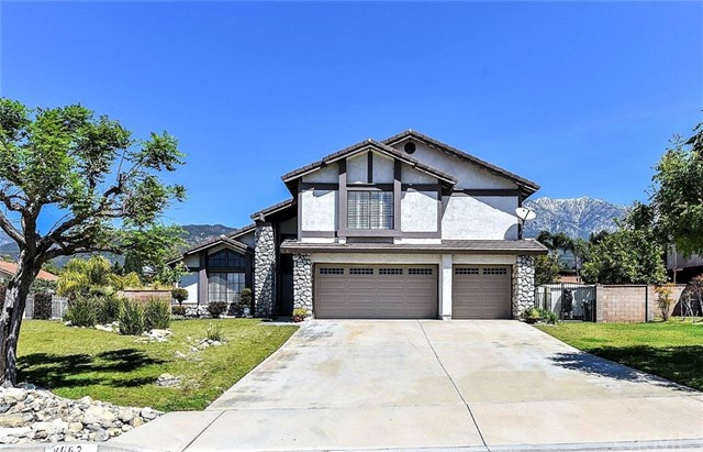 Located in an award-winning Alta Loma School w/ low tax (approx. 1.16%) & no HOA on a large cul-de-sac! Property features 4 beds, 2.5 baths, 3 car garage, and side gate available for RV parking. Extra large lot offers opportunity to build a stand alone guest house of 1,200 SF or an attached unit of 500 SF according to city. Front double door entry welcomes you into a cozy living rm w/ high ceilings and formal dining rm which offers plenty of natural light. Wood shutters throughout, tile flooring and recently upgraded laminate wood flooring on both levels including stairs. Remodeled kitchen w/ modern counter tops, updated cabinets, luxury range hood, and stove. Spacious family rm equipped w/ cozy fireplace and an individual laundry rm completes the 1st floor. Plenty of windows overlooking the pool, Jacuzzi, and spacious backyard surrounded by palm trees. Additional bath located downstairs with upgraded granite top. Large master bedroom on the 2nd floor features spacious walk-in closet & master bath w/ separate shower. Adjoined is a spacious balcony which overlooks the backyard in addition to breathtaking mountain views. Three additional beds upstairs and a full bath completes the 2nd floor. Backyard is perfect for entertaining, complete with covered patio and huge potential playground for kids. Perfect location for convenient access to shopping, freeways, walking trails, Park & schools. Buyer to verify all permits, SQFT, and accuracy of all property related info.