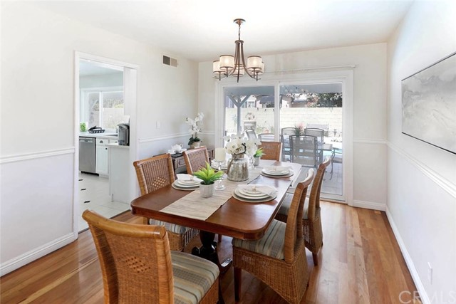 Dining Room with sliding doors opening to the backyard patio...expanding entertaining to the popular